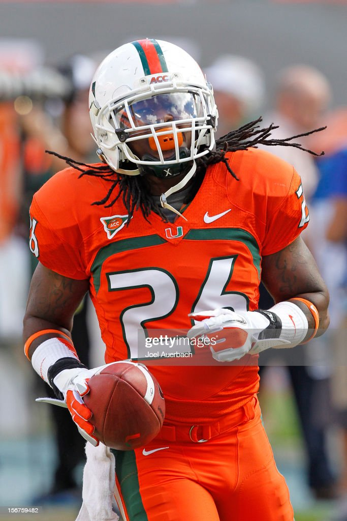 Darris Hughes #26 of the Miami Hurricanes runs with the ball prior to the game against the South Florida Bulls on November 17, 2012 at Sun Life Stadium in Miami Gardens, Florida. The Hurricanes defeated the Bulls 40-9.