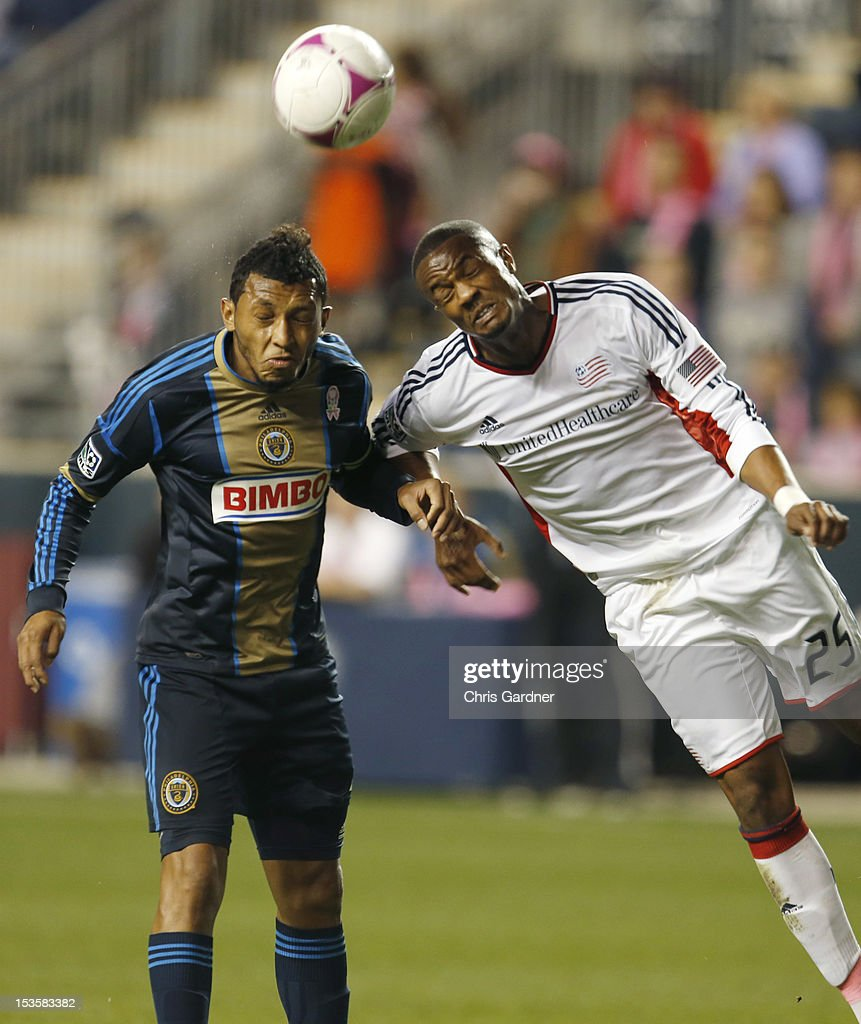 Darrius Barnes #25 of the New England Revolution battles for a head ball with Carlos Valdes #2 of the Philadelphia Union at PPL Park on October 6, 2012 in Chester, Pennsylvania.