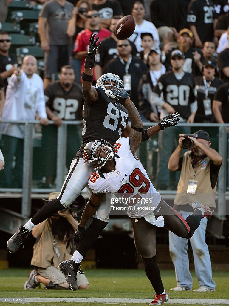 Darrius Heyward-Bey #85 of the Oakland Raiders goes up but can't make the catch in the endzone over Leonard Johnson #29 of the Tampa Bay Buccaneers during the fourth quarter of their NFL football game at O.co Coliseum on November 4, 2012 in Oakland, California. The Buccaneers won the game 42-32.