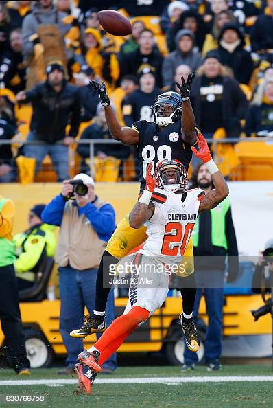 Darrius HeywardBey of the Pittsburgh Steelers makes a catch over Briean BoddyCalhoun of the Cleveland Browns in the second half during the game at...