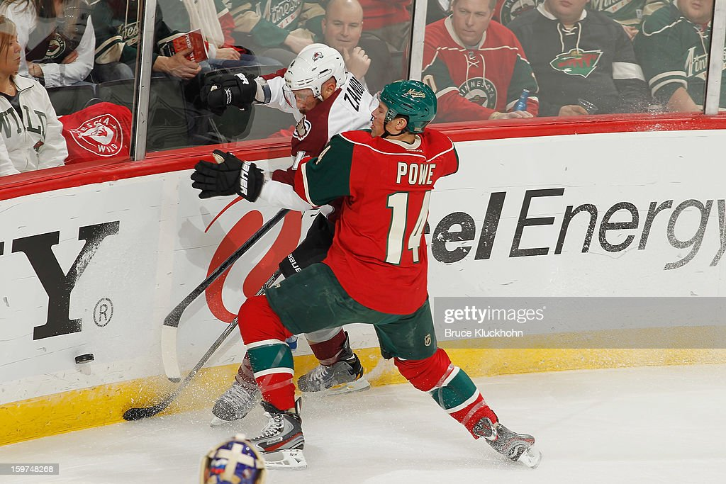 <a gi-track='captionPersonalityLinkClicked' href=/galleries/search?phrase=Darroll+Powe&family=editorial&specificpeople=4527845 ng-click='$event.stopPropagation()'>Darroll Powe</a> #14 of the Minnesota Wild and <a gi-track='captionPersonalityLinkClicked' href=/galleries/search?phrase=Greg+Zanon&family=editorial&specificpeople=567162 ng-click='$event.stopPropagation()'>Greg Zanon</a> #4 of the Colorado Avalanche battle for the puck during the game on January 19, 2013 at the Xcel Energy Center in Saint Paul, Minnesota.