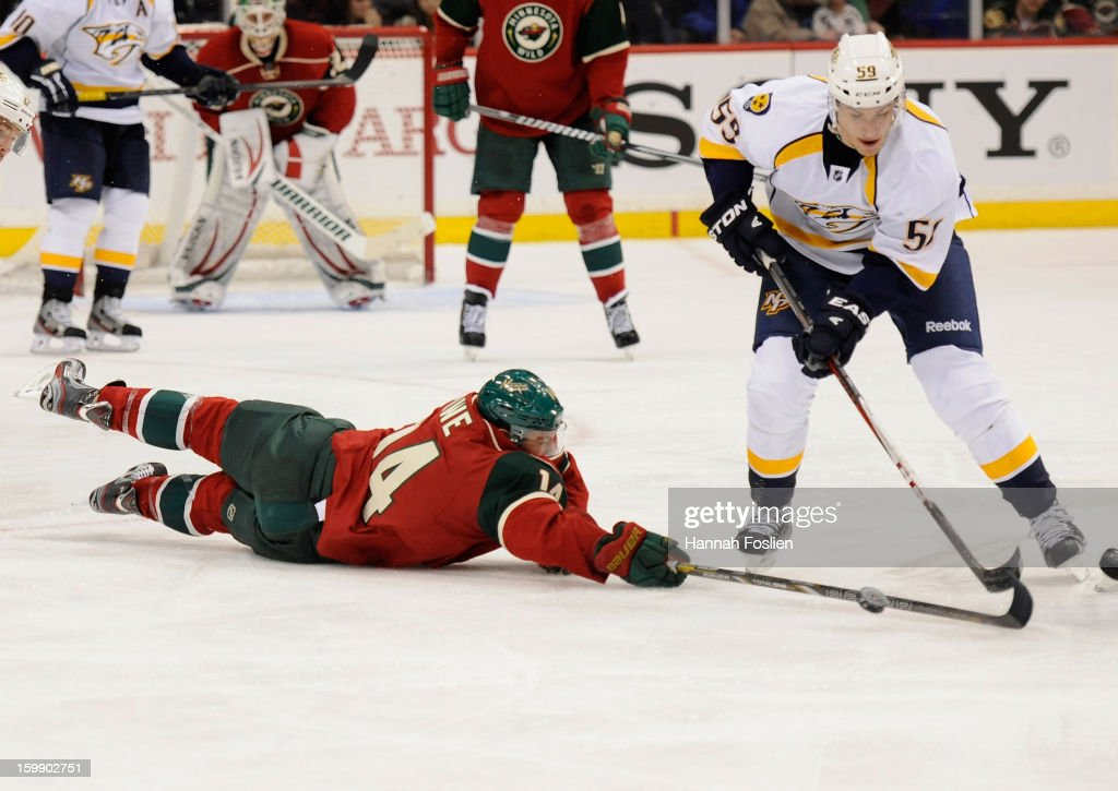 <a gi-track='captionPersonalityLinkClicked' href=/galleries/search?phrase=Darroll+Powe&family=editorial&specificpeople=4527845 ng-click='$event.stopPropagation()'>Darroll Powe</a> #14 of the Minnesota Wild and <a gi-track='captionPersonalityLinkClicked' href=/galleries/search?phrase=Roman+Josi&family=editorial&specificpeople=4247871 ng-click='$event.stopPropagation()'>Roman Josi</a> #59 of the Nashville Predators go after the puck during the third period of the game on January 22, 2013 at Xcel Energy Center in St Paul, Minnesota. The Predators defeated the Wild 3-1.