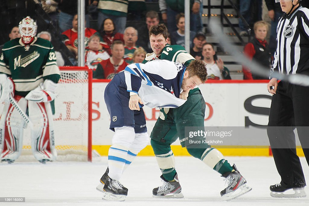 <a gi-track='captionPersonalityLinkClicked' href=/galleries/search?phrase=Darroll+Powe&family=editorial&specificpeople=4527845 ng-click='$event.stopPropagation()'>Darroll Powe</a> #14 of the Minnesota Wild and <a gi-track='captionPersonalityLinkClicked' href=/galleries/search?phrase=Tanner+Glass&family=editorial&specificpeople=4596666 ng-click='$event.stopPropagation()'>Tanner Glass</a> #15 of the Winnipeg Jets fight during the game at the Xcel Energy Center on February 16, 2012 in St. Paul, Minnesota.