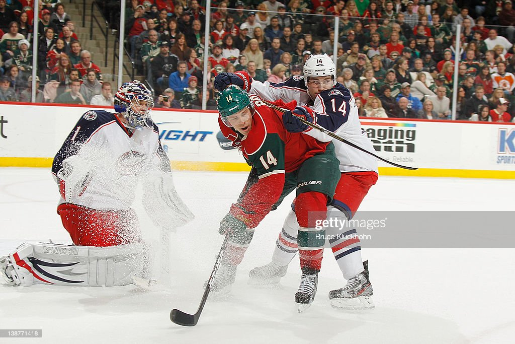 <a gi-track='captionPersonalityLinkClicked' href=/galleries/search?phrase=Darroll+Powe&family=editorial&specificpeople=4527845 ng-click='$event.stopPropagation()'>Darroll Powe</a> #14 of the Minnesota Wild fights for position with Grant Clitsome #14 and goalie Steve Mason #1 of the Columbus Blue Jackets during the game at the Xcel Energy Center on February 11, 2012 in St. Paul, Minnesota.