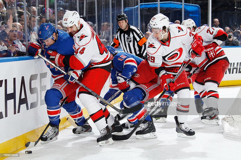<a gi-track='captionPersonalityLinkClicked' href=/galleries/search?phrase=Darroll+Powe&family=editorial&specificpeople=4527845 ng-click='$event.stopPropagation()'>Darroll Powe</a> #8 of the New York Rangers battles <a gi-track='captionPersonalityLinkClicked' href=/galleries/search?phrase=Jay+Harrison&family=editorial&specificpeople=714374 ng-click='$event.stopPropagation()'>Jay Harrison</a> #44 of the Carolina Hurricanes along the boards at Madison Square Garden on March 18, 2013 in New York City.
