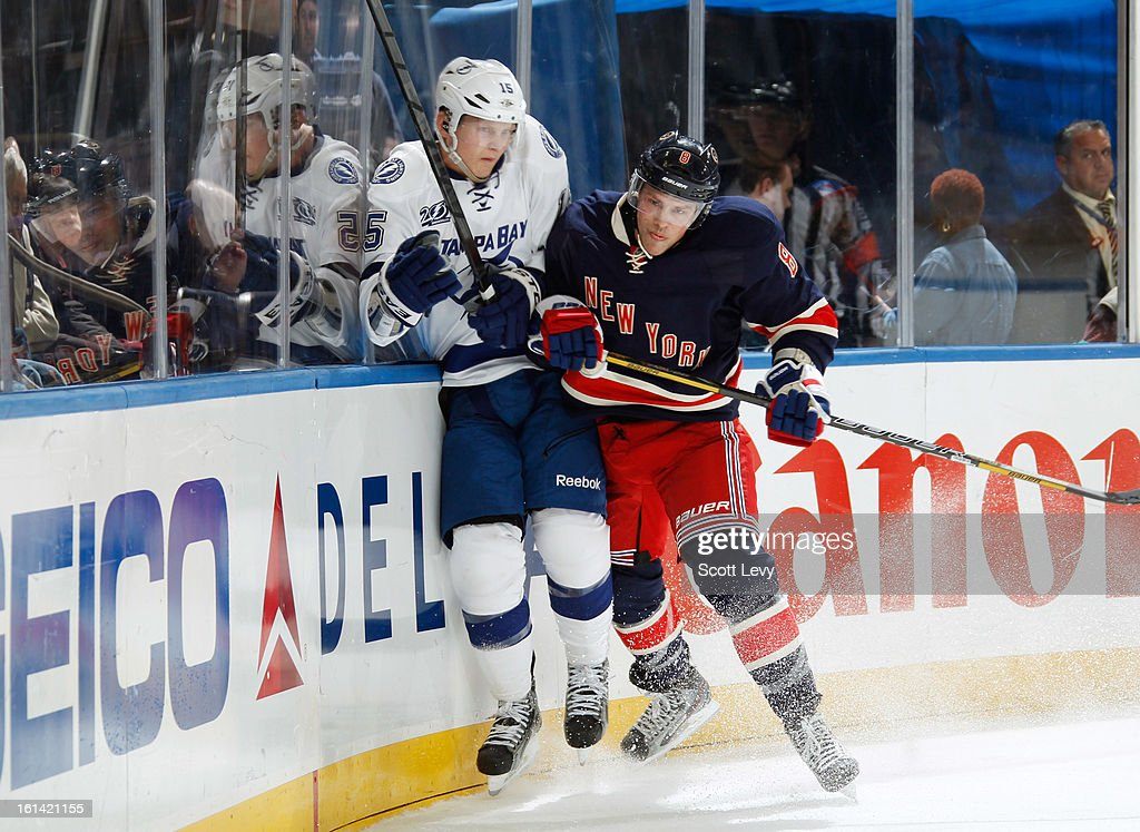 <a gi-track='captionPersonalityLinkClicked' href=/galleries/search?phrase=Darroll+Powe&family=editorial&specificpeople=4527845 ng-click='$event.stopPropagation()'>Darroll Powe</a> #8 of the New York Rangers checks Brian Lee #15 of the Tampa Bay Lightning at Madison Square Garden on February 10, 2013 in New York City. The Rangers defeat the Lightning 5-1.