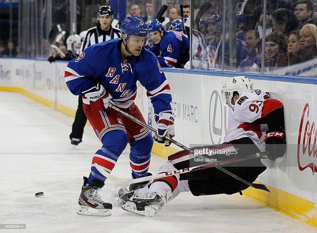 <a gi-track='captionPersonalityLinkClicked' href=/galleries/search?phrase=Darroll+Powe&family=editorial&specificpeople=4527845 ng-click='$event.stopPropagation()'>Darroll Powe</a> #8 of the New York Rangers checks \v93 into the boards at Madison Square Garden on March 8, 2013 in New York City. Senators defeated the Rangers 3-2.