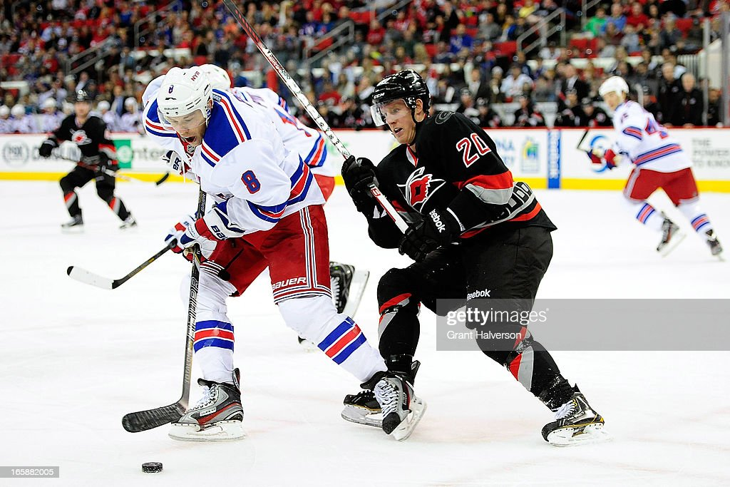 <a gi-track='captionPersonalityLinkClicked' href=/galleries/search?phrase=Darroll+Powe&family=editorial&specificpeople=4527845 ng-click='$event.stopPropagation()'>Darroll Powe</a> #8 of the New York Rangers clears the puck under pressure from Riley Nash #20 of the Carolina Hurricanes during play at PNC Arena on April 6, 2013 in Raleigh, North Carolina.