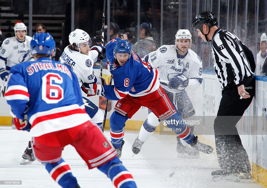 <a gi-track='captionPersonalityLinkClicked' href=/galleries/search?phrase=Darroll+Powe&family=editorial&specificpeople=4527845 ng-click='$event.stopPropagation()'>Darroll Powe</a> #8 of the New York Rangers skates against Cory Conacher #89 of the Tampa Bay Lightning at Madison Square Garden on February 28, 2013 in New York City.