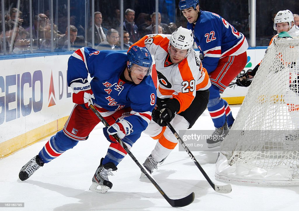 <a gi-track='captionPersonalityLinkClicked' href=/galleries/search?phrase=Darroll+Powe&family=editorial&specificpeople=4527845 ng-click='$event.stopPropagation()'>Darroll Powe</a> #8 of the New York Rangers skates against Erik Gustafsson #29 of the Philadelphia Flyers at Madison Square Garden on March 5, 2013 in New York City. The Rangers defeat the Flyers 4-2.