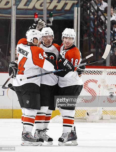 Darroll Powe of the Philadelphia Flyers celebrates his empty net goal with Kimmo Timonen and Mike Richards against the Pittsburgh Penguins on March...