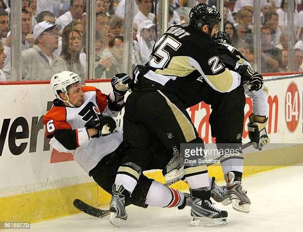 Darroll Powe of the Philadelphia Flyers is checked by Maxime Talbot of the Pittsburgh Penguins during Game Five of the Eastern Conference...