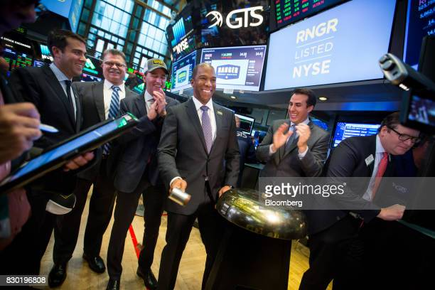 Darron Anderson president and chief executive officer of Ranger Energy Services Inc center rings a ceremonial bell during the company's initial...