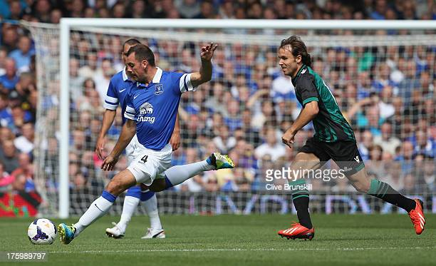 Darron Gibson of Everton clears the ball away from Joan Verdu of Real Betis during the pre season friendly match between Everton and Real Betis at at...