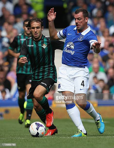 Darron Gibson of Everton moves away from Joan Verdu of Real Betis during the pre season friendly match between Everton and Real Betis at at Goodison...