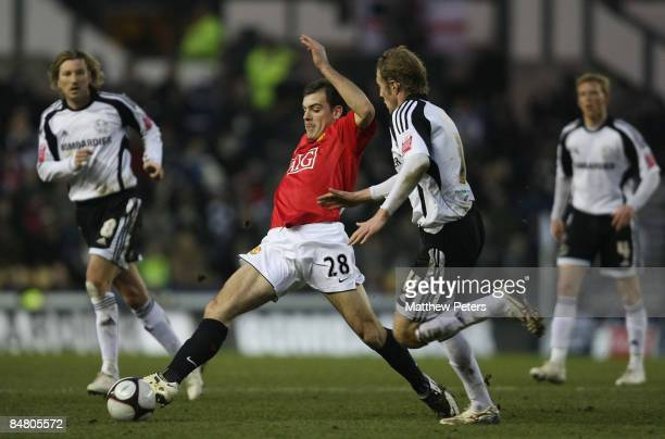 Darron Gibson of Manchester United clashes with Rob Hulse of Derby County during the FA Cup sponsored by eon Fifth Round match between Derby County...