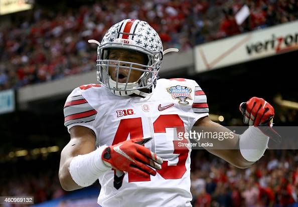 Darron Lee celebrates teammate Steve Miller of the Ohio State Buckeyes after scoring a 41 yard interception return from Blake Sims of the Alabama...