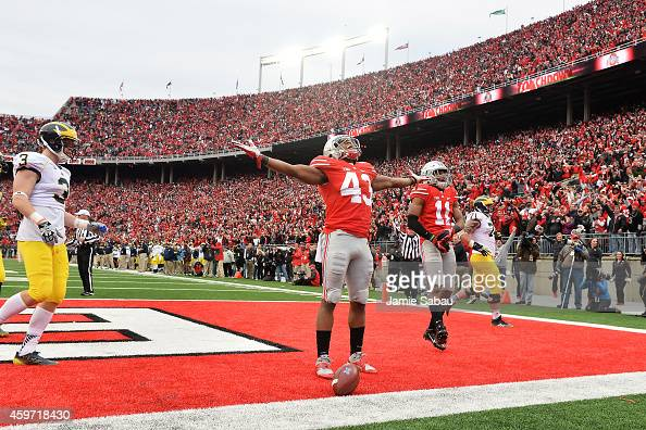 Darron Lee of the Ohio State Buckeyes celebrates after returning a recovered fumble 33yards for a touchdown in the fourth quarter against the...