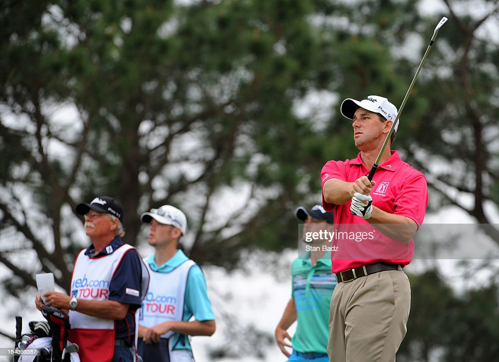 Darron Stiles watches his tee shot on the sixth hole during the third round of the Chitimacha Louisiana Open at Le Triomphe Country Club on March 23, 2013 in Broussard, Louisiana.