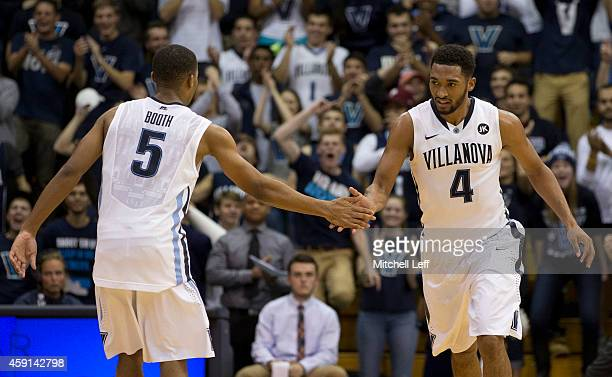 Darrun Hilliard and Phil Booth of the Villanova Wildcats react after Hilliard dunked the ball in the first half against the Maryland Eastern Shore...