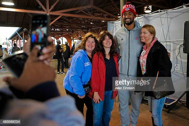 Darrun Hilliard II of the Detroit Pistons participates in the Slow Roll event on October 19 2015 at the Eastern Market and The Detroit Boxing Gym in...