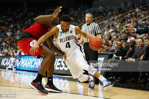 Darrun Hilliard II of the Villanova Wildcats drives against AbdulMalik Abu of the North Carolina State Wolfpack in the first half during the third...