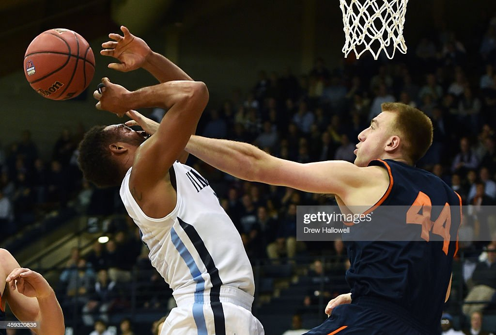 <a gi-track='captionPersonalityLinkClicked' href=/galleries/search?phrase=Darrun+Hilliard&family=editorial&specificpeople=8710176 ng-click='$event.stopPropagation()'>Darrun Hilliard</a> II #4 of the Villanova Wildcats is fouled by Ben Oberfeld #44 of the Bucknell Bison at The Pavilion on November 20, 2014 in Villanova, Pennsylvania.