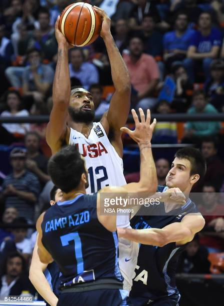 Darrun Hilliard II of United States fights for ball with Facundo Campazzo and Nicolas Brussino of Argentina during the FIBA Americup final match...