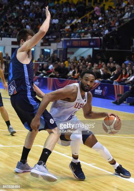 Darrun Hilliard II of United States fights for the ball with Nicolas Brussino of Argentina during the FIBA Americup final match between US and...