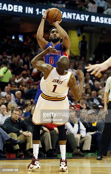Darrun Hilliard of the Detroit Pistons commits an offensive foul against James Jones the Cleveland Cavaliers during the first half at Quicken Loans...