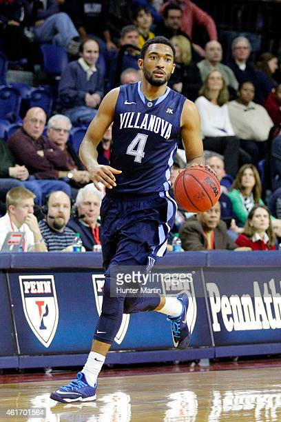 Darrun Hilliard of the Villanova Wildcats dribbles the ball up the court during a game against the Penn Quakers at the Palestra on the campus of the...