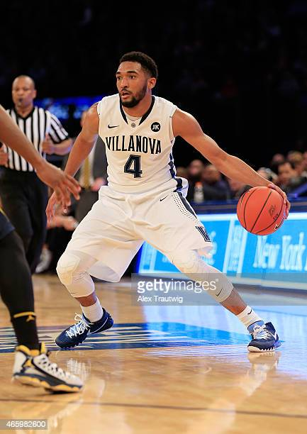 Darrun Hilliard of the Villanova Wildcats drives to the basket against the Marquette Golden Eagles during a quarterfinal game of the Big East...
