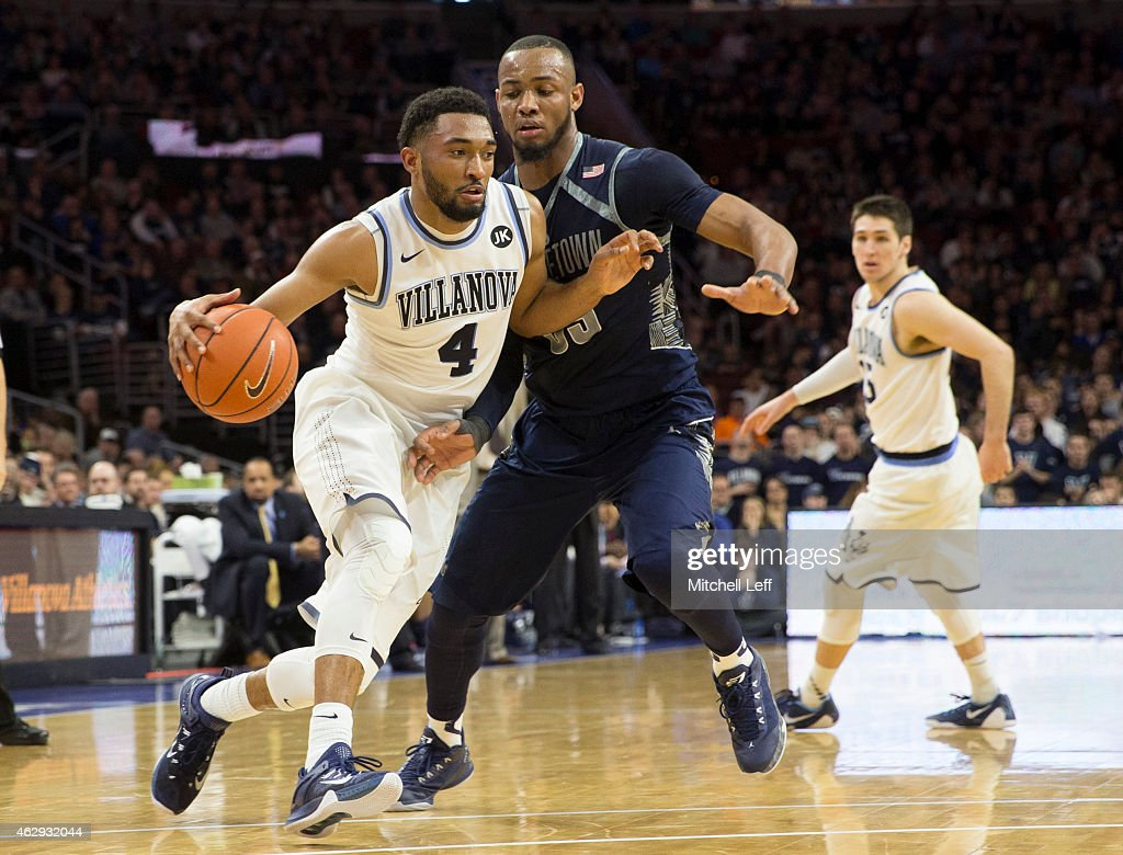 <a gi-track='captionPersonalityLinkClicked' href=/galleries/search?phrase=Darrun+Hilliard&family=editorial&specificpeople=8710176 ng-click='$event.stopPropagation()'>Darrun Hilliard</a> #4 of the Villanova Wildcats drives to the basket with <a gi-track='captionPersonalityLinkClicked' href=/galleries/search?phrase=Jabril+Trawick&family=editorial&specificpeople=8627465 ng-click='$event.stopPropagation()'>Jabril Trawick</a> #55 of the Georgetown Hoyas defending on February 7, 2015 at the Wells Fargo Center in Philadelphia, Pennsylvania. The Wildcats defeated the Hoyas 69-53.