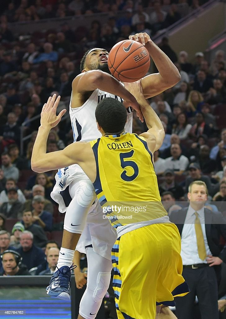 <a gi-track='captionPersonalityLinkClicked' href=/galleries/search?phrase=Darrun+Hilliard&family=editorial&specificpeople=8710176 ng-click='$event.stopPropagation()'>Darrun Hilliard</a> #4 of the Villanova Wildcats is fouled by Sandy Cohen III #5 of the Marquette Golden Eagles at the Wells Fargo Center on February 4, 2015 in Philadelphia, Pennsylvania.