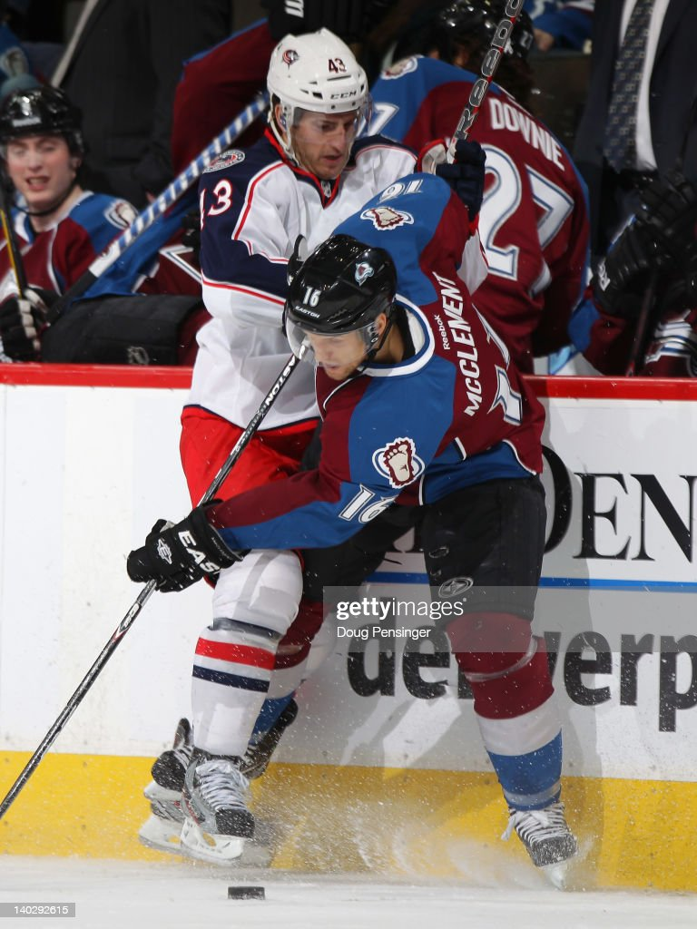 Darryl Boyce #43 of the Columbus Blue Jackets puts a hit on Jay McClement #16 of the Colorado Avalanche at the Pepsi Center on March 1, 2012 in Denver, Colorado.