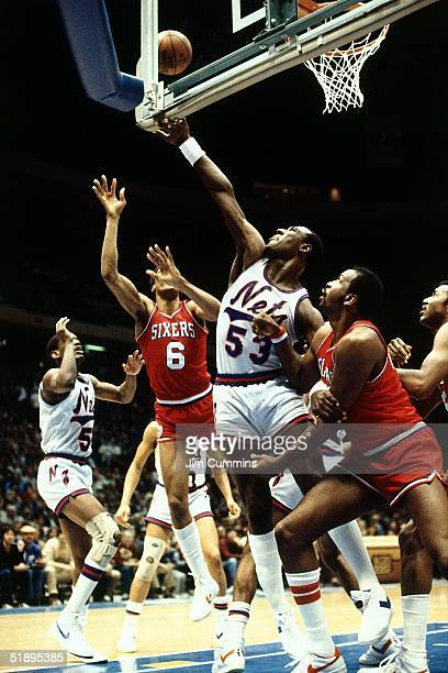 Darryl Dawkins New Jersey Nets battles for a rebound against his former teammates the Philadelphia 76ers during an NBA game in 1983 at Brendan Byrne...