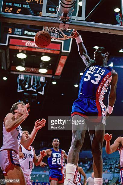 Darryl Dawkins of the New Jersey Nets dunks against the San Diego Clippers during a game played circa 1980 at the San Diego Sports Arena in San Diego...