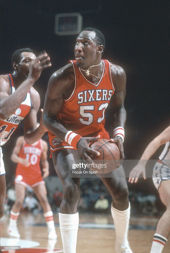 Darryl Dawkins of the Philadelphia 76ers looks to shoot over Elvin Hayes of the Washington Bullets during an NBA basketball game circa 1979 at the...