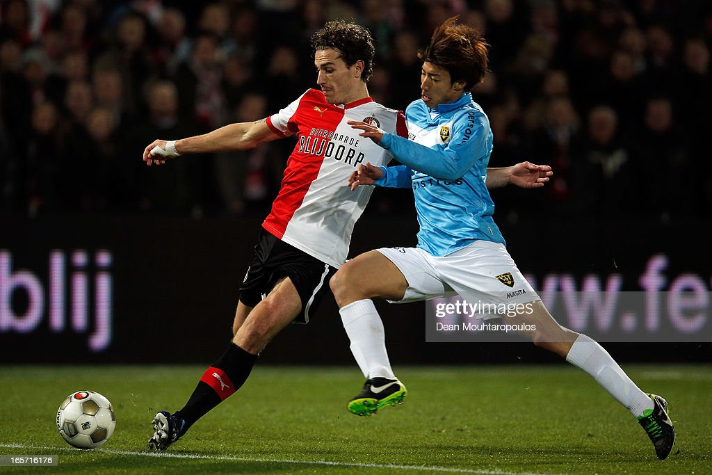 Darryl Janmaat of Feyenoord is tackled by <a gi-track='captionPersonalityLinkClicked' href=/galleries/search?phrase=Yuki+Otsu&family=editorial&specificpeople=7538227 ng-click='$event.stopPropagation()'>Yuki Otsu</a> of Venlo during the Eredivisie match between Feyenoord and VVV Venlo at De Kuip on April 5, 2013 in Rotterdam, Netherlands.