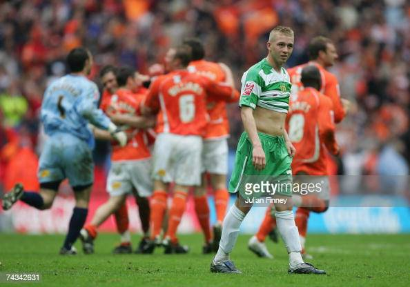 Darryl Knights of Yeovil looks on as Blackpool players celebrate promotion after the League one Playoff Final match between Blackpool and Yeovil at...