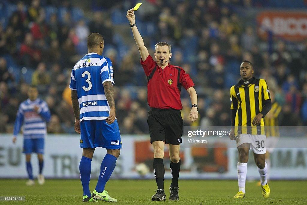 Darryl Lachman of PEC Zwolle, referee Johan Verbist of Belgium, Renato Ibarra of Vitesse during the Dutch Eredivisie match between Vitesse Arnhem and PEC Zwolle at the Gelredome on march 31, 2013 in Arnhem, The Netherlands