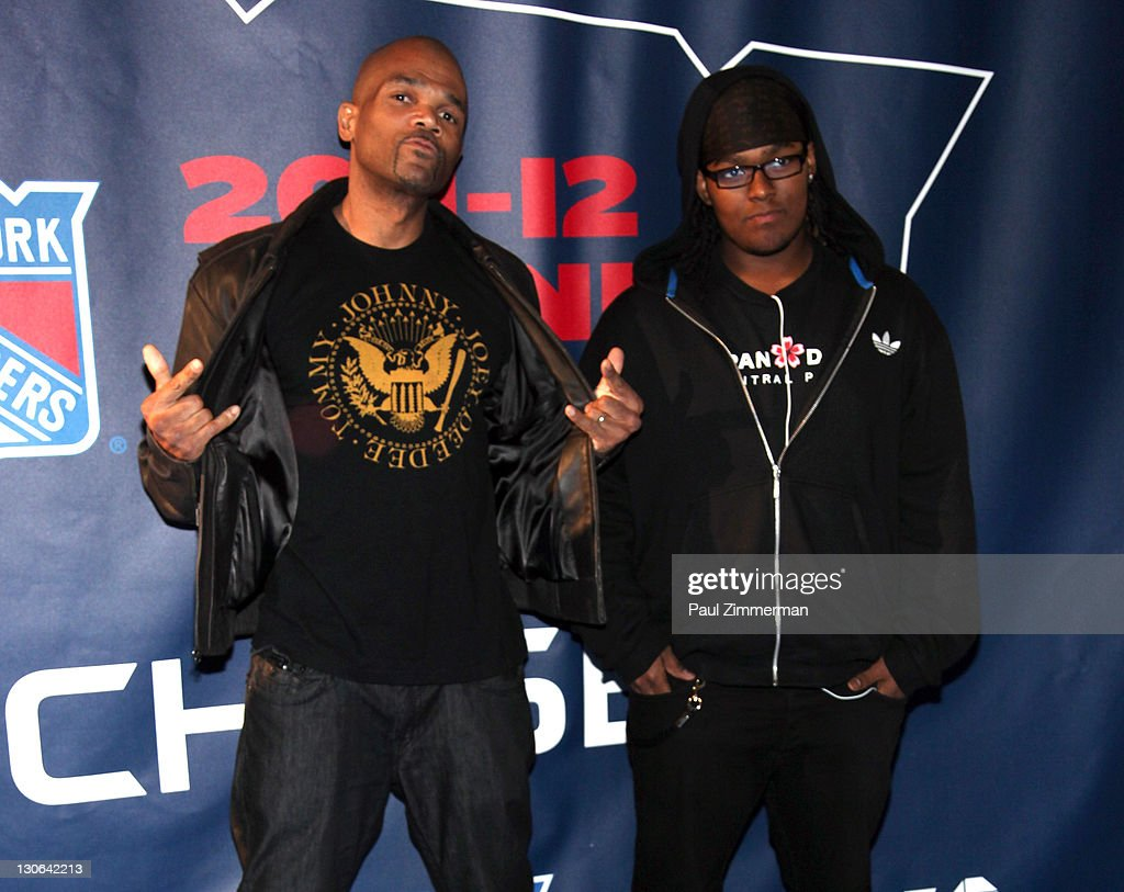 <a gi-track='captionPersonalityLinkClicked' href=/galleries/search?phrase=Darryl+McDaniels&family=editorial&specificpeople=175934 ng-click='$event.stopPropagation()'>Darryl McDaniels</a> and Darryl M. McDaniels, Jr. attend the New York Rangers home opener at Madison Square Garden on October 27, 2011 in New York City.