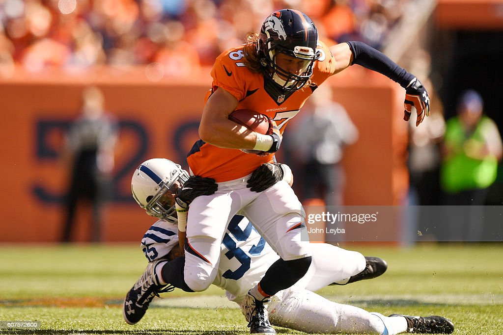 74df89926 ... of the Indianapolis Colts brings down Jordan Taylor (87) New England  Patriots 87 Rob Gronkowski 2015 Super Bowl XLIX Drenched Limited Blue  Jersey Nike ...