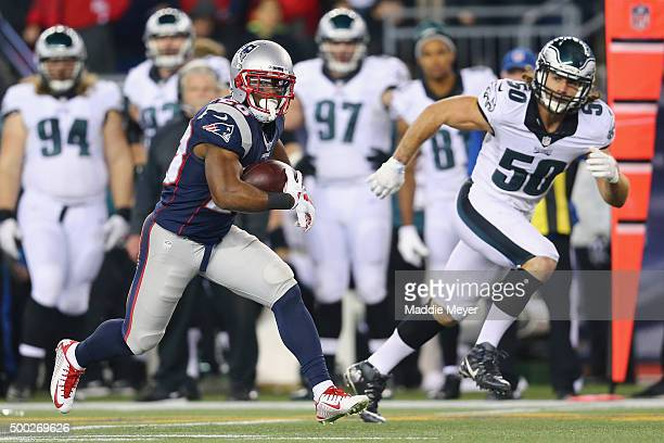 Darryl Roberts of the New England Patriots carries the ball with pressure from Kiko Alonso of the Philadelphia Eagles at Gillette Stadium on December...