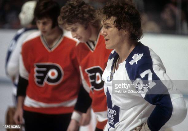 Darryl Sittler of the Toronto Maple Leafs and Bobby Clarke of the Philadelphia Flyers look on after a fight during an NHL game circa 1972 at the...