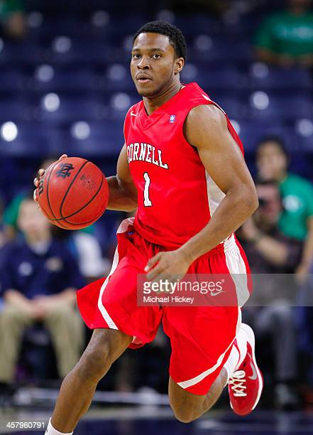 Darryl Smith of the Cornell Big Red brings the ball up court against the Notre Dame Fighting Irish at Purcel Pavilion on December 1 2013 in South...