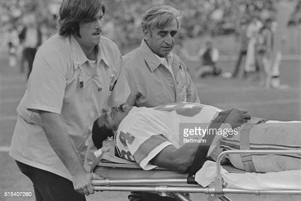 Darryl Stingley the New England Patriot's outstanding wide receiver is removed from playing field after he suffered a broken neck here in the...