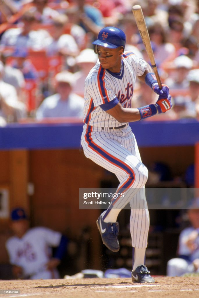<a gi-track='captionPersonalityLinkClicked' href=/galleries/search?phrase=Darryl+Strawberry&family=editorial&specificpeople=206190 ng-click='$event.stopPropagation()'>Darryl Strawberry</a> of the New York Mets steps into the swing during a game in the 1990 season. (Photo by: Scott Halleran/Getty Images