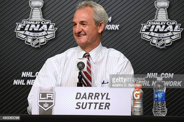 Darryl Sutter of the Los Angeles Kings answers questions from the media following his team's victory over the New York Rangers in Game One of the...