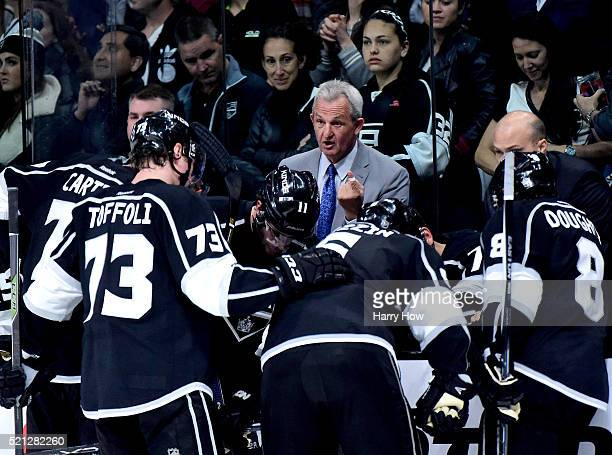 Darryl Sutter of the Los Angeles Kings speaks to his players during a timeout in the third period of a 43 Sharks win in Game One of the Western...
